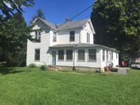 Rental house and storage buildings on 4.2 acres that