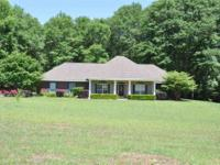 Beautiful Home on 2.3 acre lot. French doors open onto