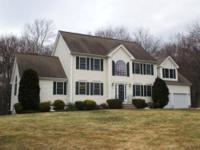 Awesome oversized four bedroom colonial located at the