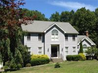 Lovely center hall colonial on level lot on small cul