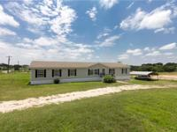 Home on 1 acre corner lot in Springtown. Driveway