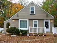 Home for the holidays! This four bedroom, two bath cape