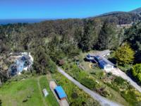 Located in the warm valley behind Montara Beach, this 4