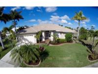 This spacious 4 bedroom/2 bath waterfront pool home is