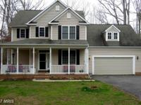 Main level master in this 4br/2.5 ba colonial in lake