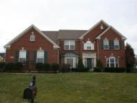 Exceptional 4 BR Home situated on a Half Acre +