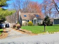 Updated 4 Br 2 Full Bth Cape on 1+ acre of Wooded land.