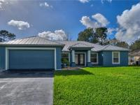 Key West Beauty! Four bedroom, two bath, two car garage