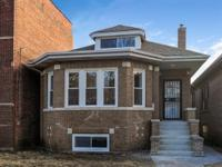 Spectacular rehab of a brick bungalow with second story