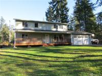 Spacious 4 bedroom home with a view of Spencer Lake.