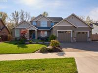 Absolutely stunning custom home complete w/upscale