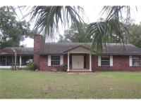 Older, solid 3/2 or 4/2 block home on 2 acres with a
