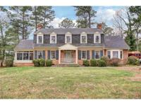 This classically constructed, brick Dutch Colonial is