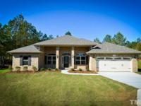 Awesome all brick Ranch 2169 Plan with a 3 car garage