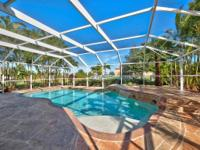 This Magnificent Screened Pool Home Features 4 Bedroom,