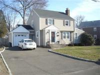 Mint updated 8 room, 4 bedroom, 2 full bath colonial