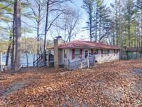 This Fee Simple, 4 bedroom, 2 bath Lake Burton cabin is