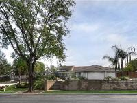 Located on a beautiful tree lined street, the expansive