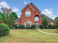 Located in desirable Greenwood Village this spacious 4