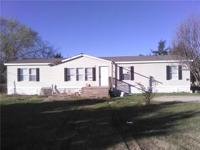 Great double wide on massive lot .78 of an acre , large