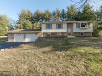 Beautifully Updated Split Foyer on Private1.5 acre lot.
