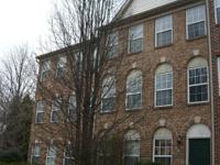 Nice 4 br, 2 ba, brick front townhome in sought after