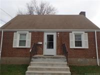 Updated 4 BR Cape with new kitchen with white cabinets,