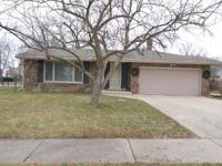 Gorgeous spacious brick home on large corner lot! This