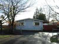 Spacious manufactured home on a oversized lot! Great