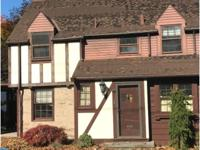 Check out this Tudor home sitting on a corner lot. Two