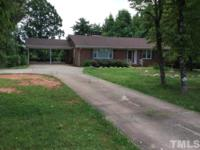 Brick Ranch W/ 4 Bedrooms, large Living Room w/ Gas Log