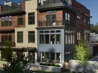 Eya elevator townhomes at grosvenor heights, a wooded