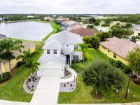 Four+ beds w/lake views! This immaculate 2-story boasts