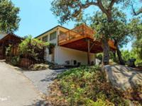 Charming custom home, nestled amongst oak trees, with