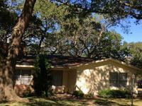Beautiful old Oak trees surround this corner property