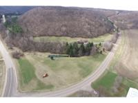 Luxury Home on apprx. 5 acres w/main floor living,