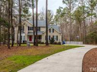 Beautiful home, nestled on 2.33 acres of privacy! Rear