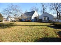 Very well maintained four bedroom cape home in