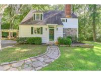 Lower Weston story book colonial tucked away on a