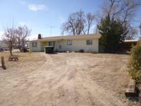 Country home in city limits of Ordway. This 4 bedroom,