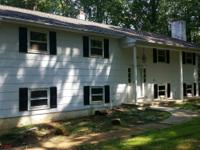 Neat and clean bi-level on 3 acres wooded lot features