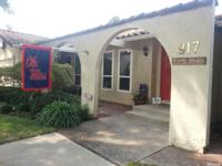 This Spanish Style Lakewood School District Home is a