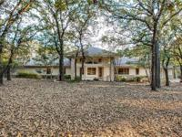 Gorgeous 4 bedroom contemporary on 4 heavily wooded