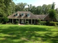 This One Has It All!! 9.23 Acres including lake & new