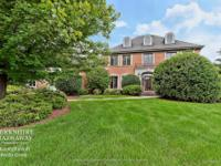 Nestled on a private 1.4 acre lot, this custom,