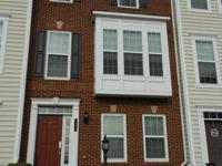 Perfect commuter oasis!! Lovely brick front townhome in