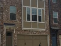 Gorgeous 3 story townhome! Family Room with Fireplace,
