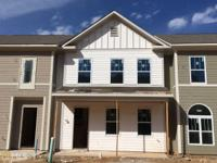Townhomes are under construction with an estimated