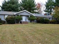 Enjoy single story living on over 2 1/2 acre lot. This