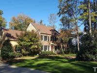 Brick front beauty on nearly 1 acre lot in prime Cary
